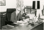 Photograph of J. Garber Drushal at a Desk