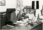 Photograph of J. Garber Drushal at a Desk
